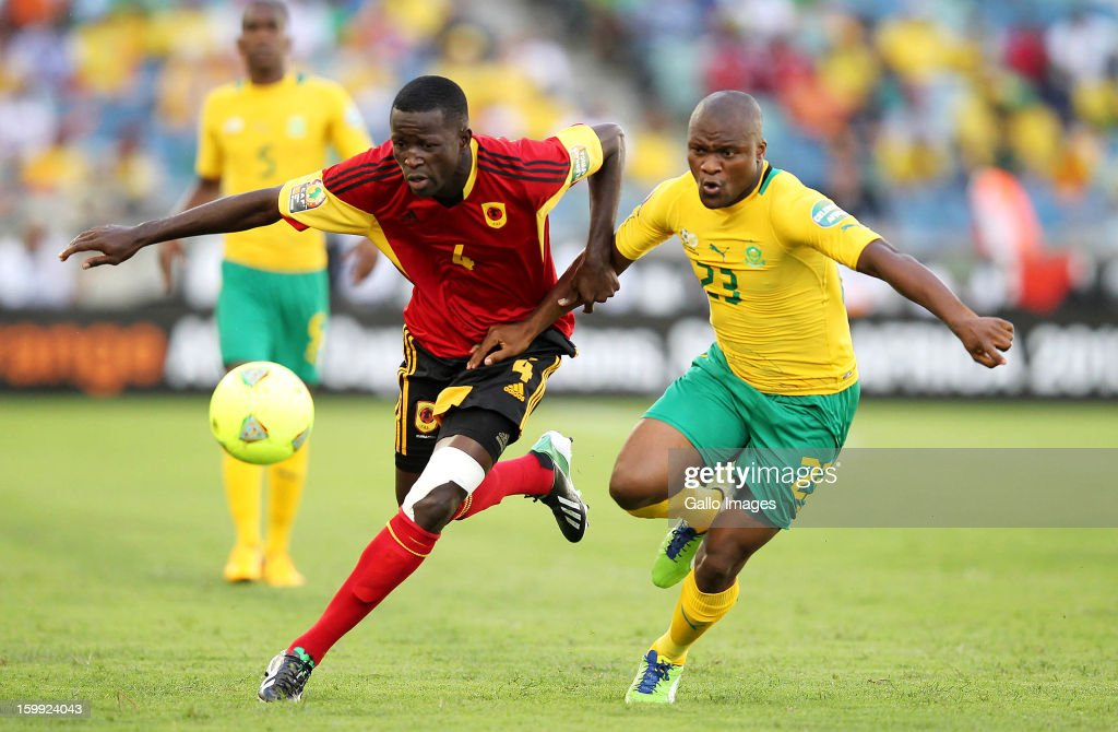 Tokoleo Anthony Rantie of South Africa and Massunguna Alex Afonso of Angola during the 2013 African Cup of Nations match between South Africa and Angola from Moses Mabhida Stadium on January 23, 2012 in Durban, South Africa.