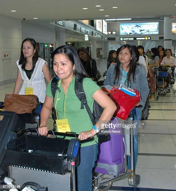 Tokoname, Japan - Seventy nurses arrive from the Philippines at Chubu Centrair International Airport near Nagoya on May 29, 2011. Nearly 30 Filipino...