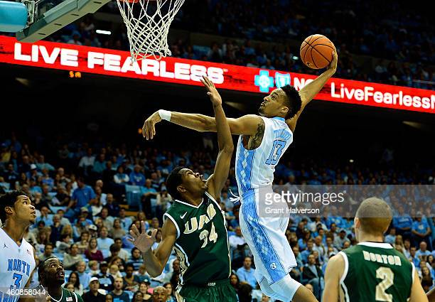 Tokoto of the North Carolina Tar Heels dunks over William Lee of the UAB Blazers during their game at the Dean Smith Center on December 27, 2014 in...