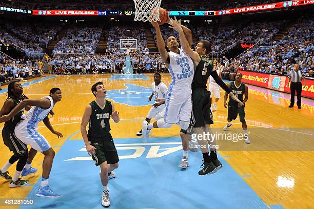 P Tokoto of the North Carolina Tar Heels goes to the basket against Greg Malinowski of the William Mary Tribe during their game at the Dean Smith...