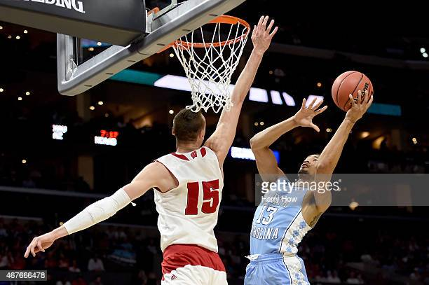P Tokoto of the North Carolina Tar Heels goes up for a shot against Sam Dekker of the Wisconsin Badgers in the first half during the West Regional...
