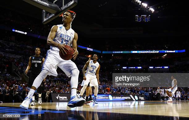 P Tokoto of the North Carolina Tar Heels reacts after dunking the ball against the Providence Friars during the first half of the second round of the...