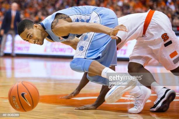 P Tokoto of the North Carolina Tar Heels scrambles for a loose ball stripped from CJ Fair of the Syracuse Orange during the first half on January 11...