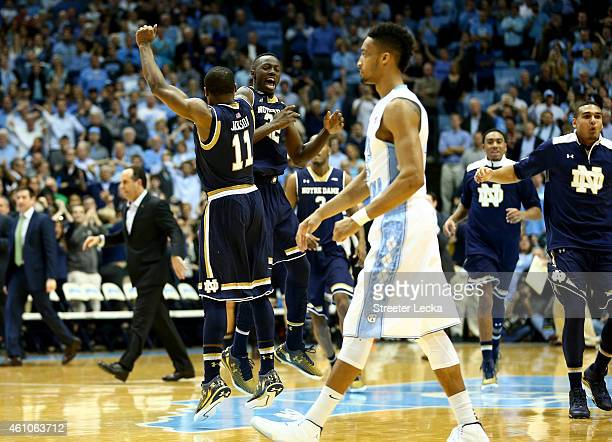P Tokoto of the North Carolina Tar Heels walks off the floor as teammates Demetrius Jackson and Jerian Grant of the Notre Dame Fighting Irish...