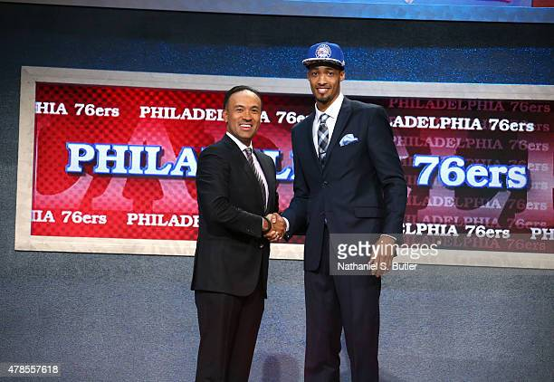 P Tokoto shakes hands with Deputy Commissioner and Chief Operating Officer of the National Basketball Association Mark Tatum after being selected...