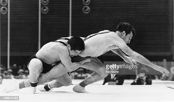 Tokuaki Fujita of Japan and Davit Gvantseladze of the Soviet Union competing in the final round of the lightweight GrecoRoman wrestling event at the...