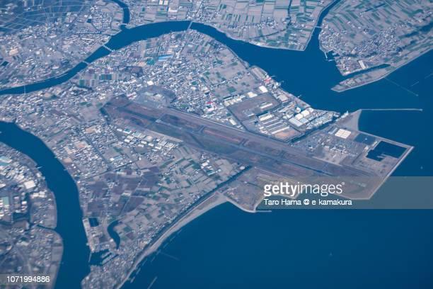 Tokushima Awaodori Airport (TKS) in Matsushige town in Tokushima prefecture in Japan daytime aerial view from airplane