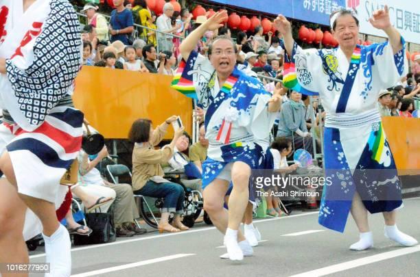 Tokushima City Mayor Akiyoshi Endo performs during the Awa Odori dance festival on August 12 2018 in Tokushima Japan The dance festival which had...