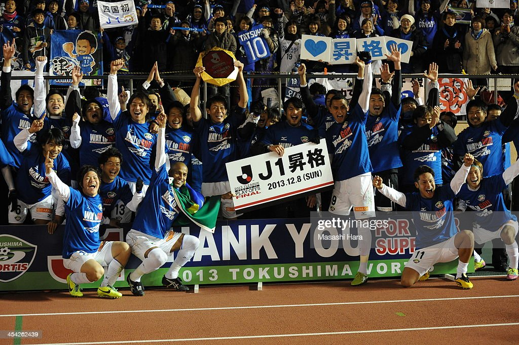 Tokushima Vortis players celebrate promoting to J.League top division after the J.League Play-Off final match between Kyoto Sanga and Tokushima Vortis at the National Stadium on December 8, 2013 in Tokyo, Japan. Tokushima Vortis pronoted to J.League top division through the play-off.
