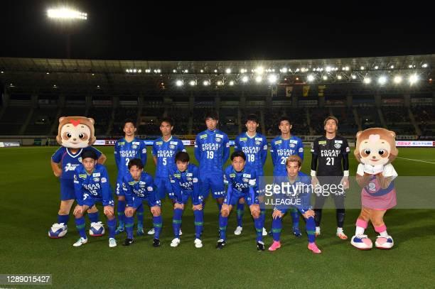 Tokushima Vortis players line up for the team photos prior to the J.League Meiji Yasuda J2 match between Tokushima Vortis and Giravanz Kitakyushu at...