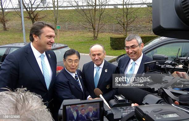 Tokyo 2020 Olympic Games bidding committee CEO Masato Mizuno and staffs of Istanbul bidding committee pose for photographs in front of International...