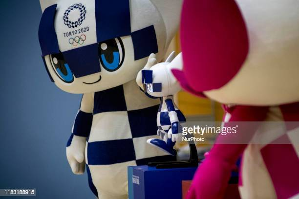 Tokyo 2020 Olympic Games' mascot and robottype mascot Miraitowa attend a ceremony at Hoyonomori elementary school in Tokyo on November 18 2019