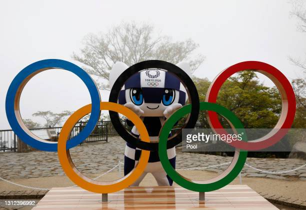 Tokyo 2020 Olympic Games mascot Miraitowa poses with the Olympic Symbol after unveiling ceremony on Mt. Takao to mark 100 days before the start of...
