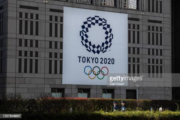 Tokyo 2020 Olympics banner is displayed on the side of a building on March 19, 2020 in Tokyo, Japan. As Japanese and IOC officials continued to...