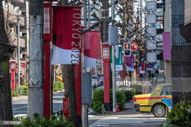 Tokyo 2020 Olympics flags are hung along a street on March 18, 2020 in Tokyo, Japan. Despite a statement yesterday by the International Olympic...