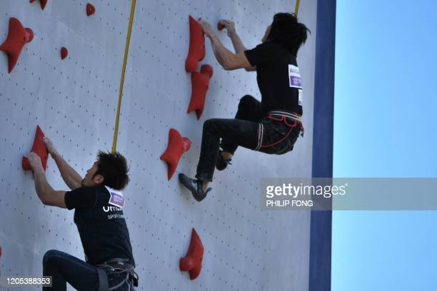 Tokyo 2020 Organizing staff climb a wall during a speed climbing test in Tokyo on March 6 2020