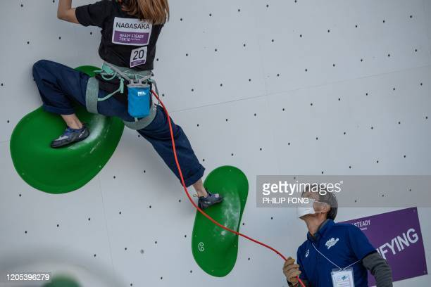 A Tokyo 2020 organizing staff wearing a facemask attends a lead climbing test in Tokyo on March 6 2020