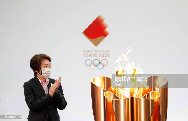 Tokyo 2020 President Seiko Hashimoto applauds next to the celebration cauldron during the opening ceremony ahead of the the first day of the Tokyo...