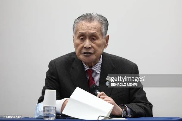 Tokyo 2020 president Yoshiro Mori announces a new date for the Olympics during a press conference in Tokyo on March 30 2020 Postponed Tokyo Olympics...