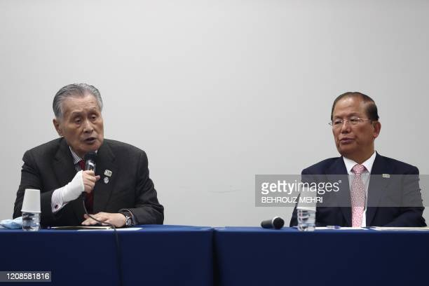 Tokyo 2020 president Yoshiro Mori answers a question as Chief executive officer of the Tokyo 2020 Olympics Toshiro Muto listens during a press...