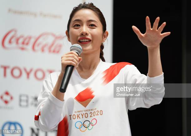 Tokyo 2020 Torch Relay Official Ambassador Satomi Ishihara speaks during the Tokyo 2020 Torch Relay 300 Days To Go event at the Tokyo Midtown on June...