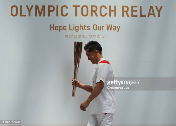 Tokyo 2020 Torch Relay Official Ambassador Tadahiro Nomura holds the Tokyo 2020 Olympic Games torch upon his arrival at the Tokyo 2020 Torch Relay...