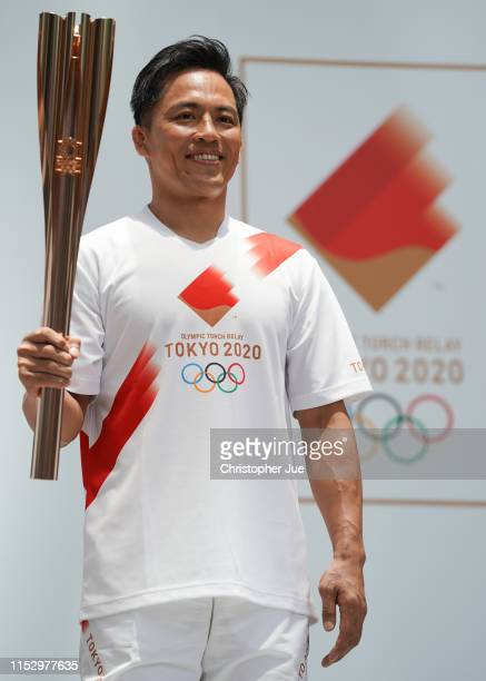 Tokyo 2020 Torch Relay Official Ambassador Tadahiro Nomura holds the Tokyo 2020 Olympic Games torch at the Tokyo 2020 Torch Relay 300 Days To Go...