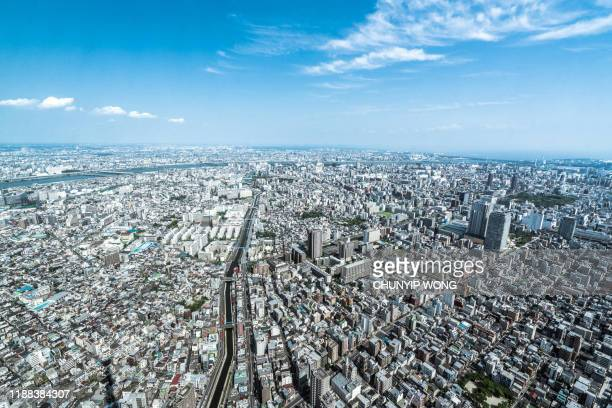 tokyo aerial panorama across skyscraper cityscape - urban sprawl stock pictures, royalty-free photos & images