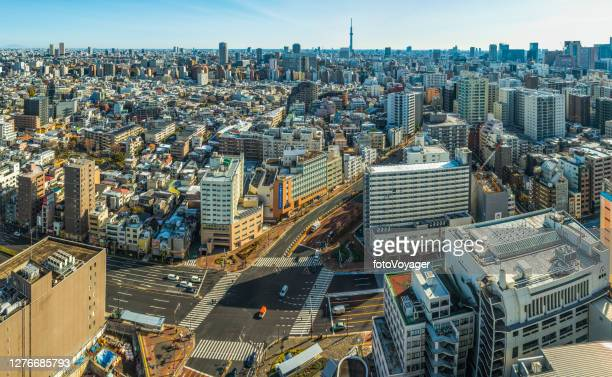 tokyo aerial panorama over cityscape overlooked by tokyo skytree japan - tokyo japan stock pictures, royalty-free photos & images