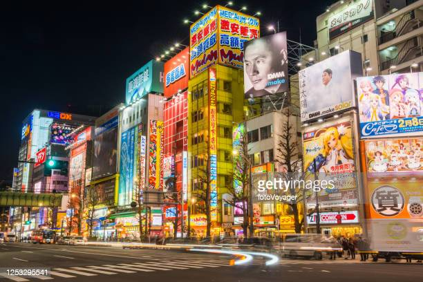 tokyo akihabara electric town billboards zooming traffic neon night japan - akihabara stock pictures, royalty-free photos & images