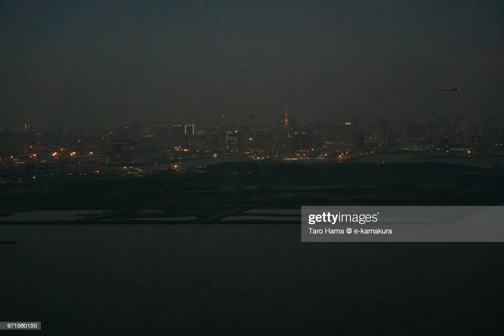 Tokyo Bay and Bayarea in Japan night time aerial view from airplane : ストックフォト