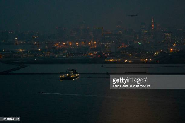 Tokyo Bay and Bayarea in Japan night time aerial view from airplane