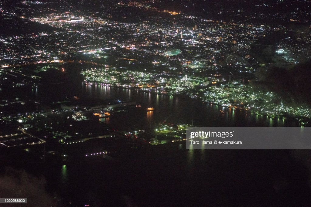 Tokyo Bay and factory area in Chiba prefecture in Japan night time aerial view from airplane : ストックフォト