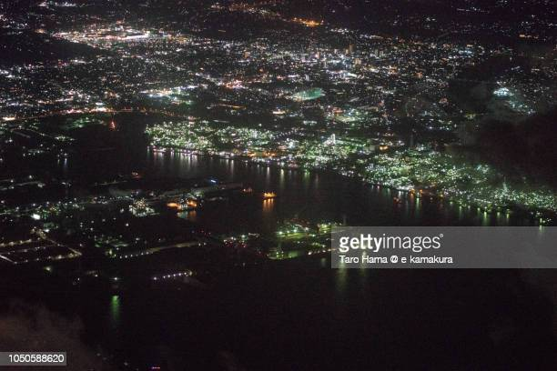 Tokyo Bay and factory area in Chiba prefecture in Japan night time aerial view from airplane