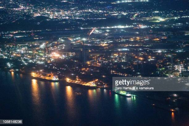 Tokyo Bay and factory area in Kimitsu city in Chiba prefecture in Japan night time aerial view from airplane