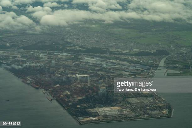 Tokyo Bay and factory in Kimitsu city in Japan daytime aerial view from airplane