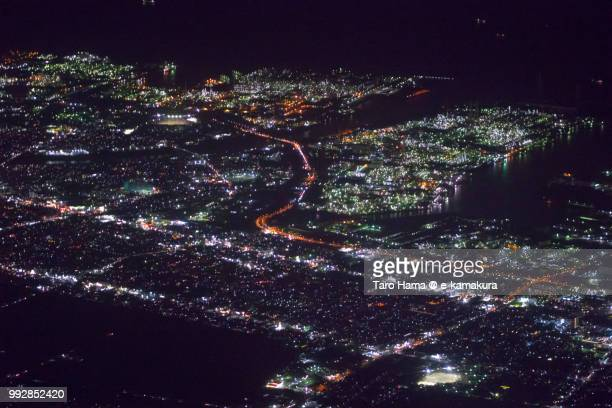Tokyo Bay and Ichihara city in Chiba prefecture in Japan night time aerial view from airplane