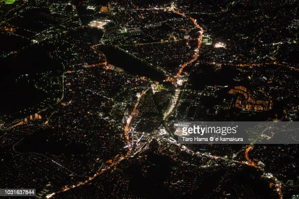 Tokyo Bay and Kanazawa-Ku of Yokohama city in Kanagawa prefecture in Japan night time aerial view from airplane