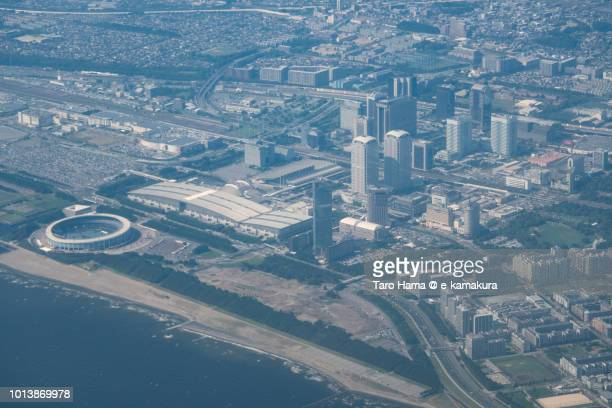 Tokyo Bay and Makuhari Messe in Chiba city in Japan daytime aerial view from airplane