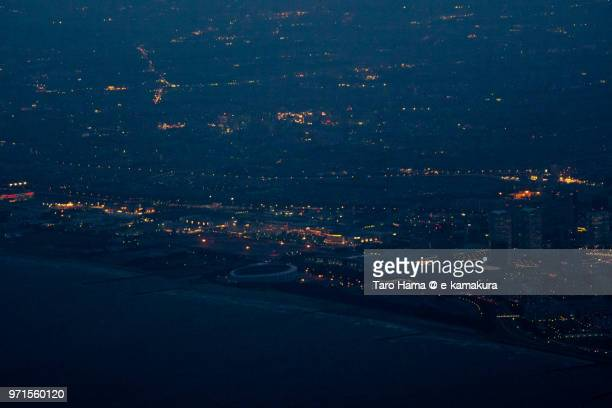 Tokyo Bay and Makuhari Messe in Chiba in Japan twilight time aerial view from airplane
