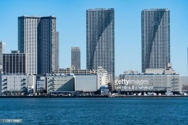 Tokyo Bay and residential buildings on Tsukishima Pier and Harumi Pier in Chuo Ward of Tokyo in Japan