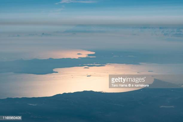 tokyo bay and sagami bay in japan sunset time aerial view from airplane - zushi kanagawa stock photos and pictures