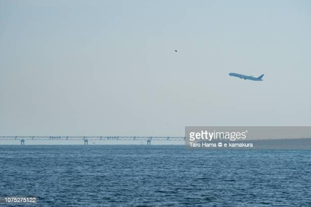 Tokyo Bay and the airplane taking off Tokyo Haneda International Airport in Tokyo in Japan