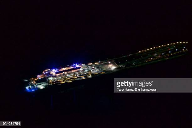 Tokyo Bay and Tokyo Aqua Line in Chiba prefecture in Japan night time aerial view from airplane
