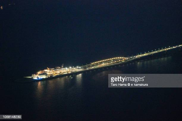 Tokyo Bay and Tokyo Bay Aqua Line in Japan night time aerial view from airplane