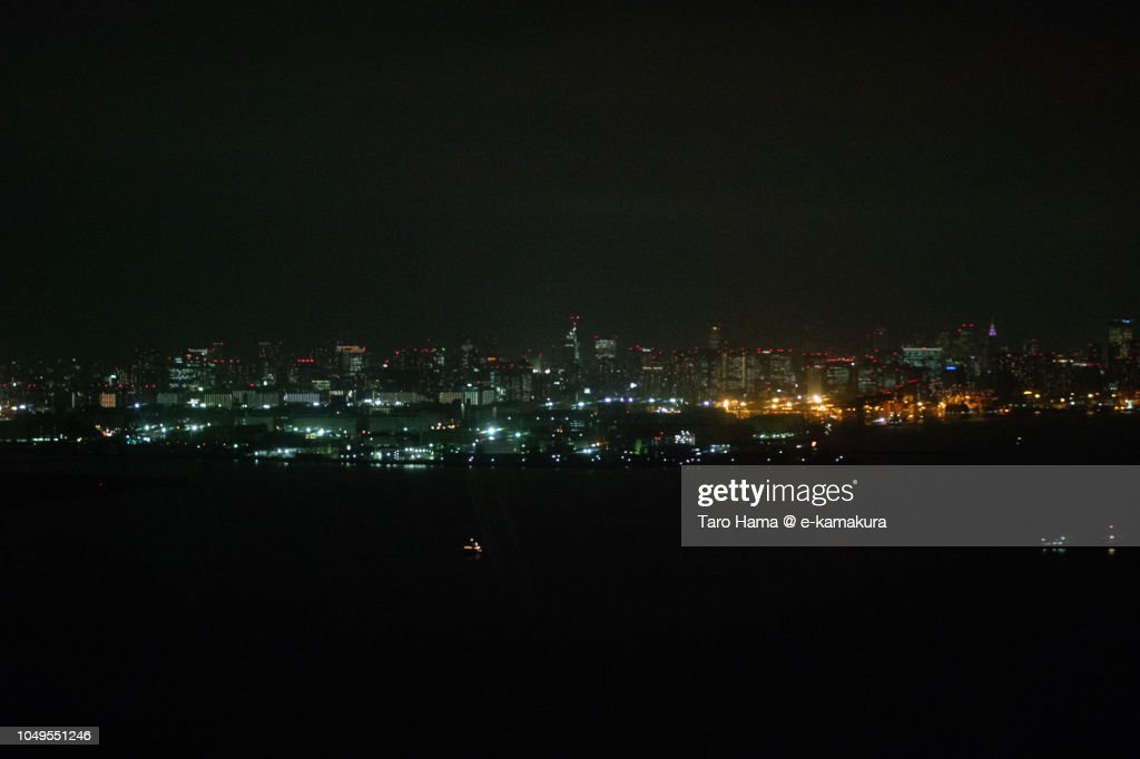 Tokyo Bay and Tokyo cityscape night time aerial view from airplane : ストックフォト