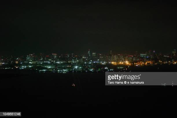 Tokyo Bay and Tokyo cityscape night time aerial view from airplane
