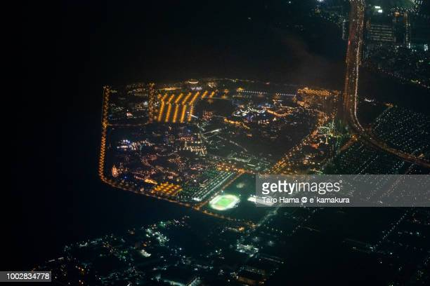 Tokyo Bay and Tokyo Disney Resort in Japan night time aerial view from airplane