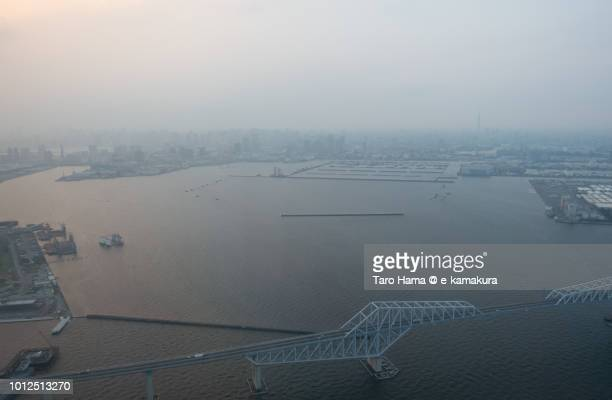 Tokyo Bay and Tokyo Gate Bridge in Tokyo in Japan sunset time aerial view from airplane