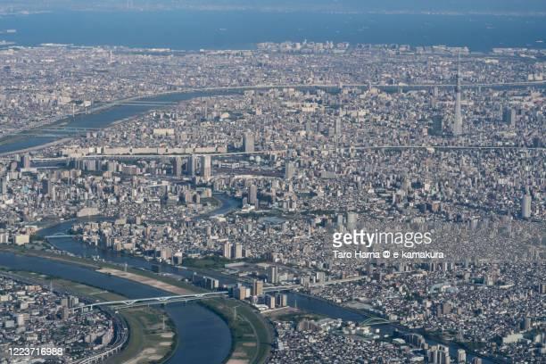 tokyo bay and tokyo sky tree in tokyo japan aerial view from airplane - chiba city fotografías e imágenes de stock